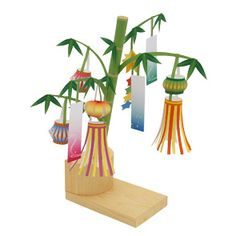 This is a bamboo decoration (sasakazari) used by the Japanese during Tanabata (Star Festival). It's a bamboo branch adorned with mini lante. Tanabata, Origami, Kids Prints, Fun Prints, Japan For Kids, Star Festival, Geography For Kids, Japan Holidays, Style Japonais
