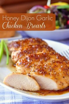 Honey Dijon Garlic Chicken Breasts - for National Garlic Day! Boneless skinless chicken breasts quickly baked in an intensely flavoured honey, garlic and Dijon mustard glaze.