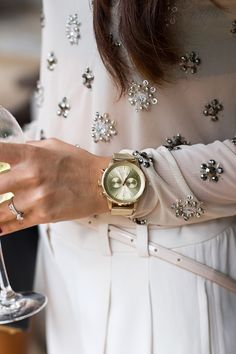 Super cute pastel pink embellished top with gold watch and white pants