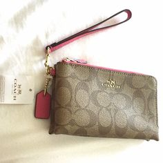 "Coach Wrislet in Khaki/Dahlia NWT wristlet from Coach. Dual compartments with 2 slots for credit cards. 6 1/2X4 1/2"". Can hold an iPhone 6. Coach Bags Clutches & Wristlets"