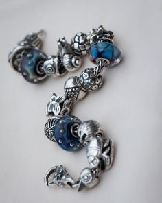 Waves and Bubbles This is not my Trollbead design but I like the selection of silvers with sparse glass. cs