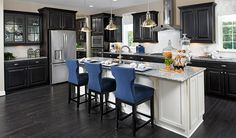 Imagine entertaining in this spacious Stafford, VA, kitchen, which boasts an immense center island contemporary, stainless-steel appliances   Donovan plan by Richmond American