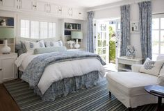 window over bed, built-ins, french doors, blue and white...love it all!!