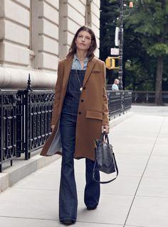 madewell flea market flare overalls worn with the teatro swing coat + mini transport crossbody.