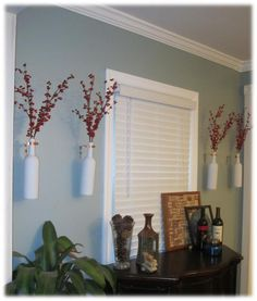 Hang wine bottles on the wall to use as vases! For mom