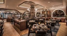 The interiors of a Chicago steakhouse recall a bygone era and pay homage to a turn-of-the century meatpacking tycoon. A view across the dining room