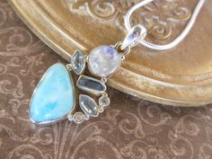 Larimar, Moonstone, and Blue Topaz Sterling Silver Pendant/Necklace