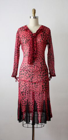 Afternoon dress ca. 1920s. Lightweight, gauzy berry-colored silk with ivy print. Ascot ties at neckline and bows at cuffs.