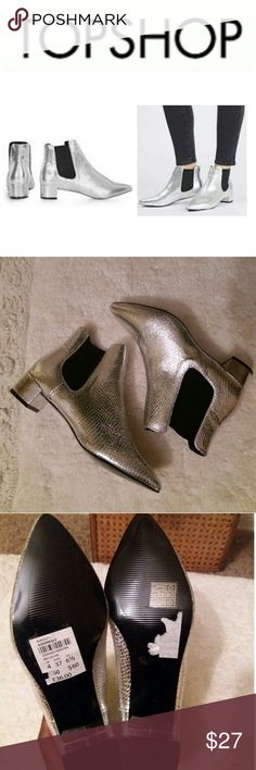 NEW Topshop Metallic Krazy Pointed Chelsea Boot Get the luxe look in these unique silver Chelsea boots featuring a small heel and pointy toe! Wed style with slim fit jeans for a chic finish! Topshop Shoes Ankle Boots & Booties