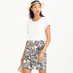 Postage-stamp mini skirt in Polynesian floral
