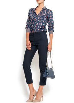 Floral print blouse + cigarette pants + nude heels + vintage inspired handbag. Lovely.