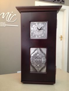 Mimmic Gallery and Studio has beautiful wall clocks / cupboards just waiting for some gorgeous pewter work to be added to them. Here the clock face and below rectangular inset have been personalized with pewter by Mary Ann Lingenfelder www.mimmic.co.za