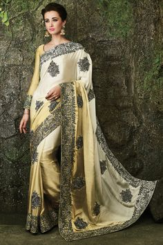 Make an enthralling appearance on any festive occasion or function by draping into this ebullient yellow color festive wear embroidered designer saree. Shop Now :- http://www.lalgulal.com/sarees/golden-shaded-heavy-satin-silk-diamond-work-bridal-wedding-saree-749 Cash On Delivery & Free Shipping only in India.For Other Query Just Whatsapp Us on +91-9512150402 Or Mail Us at info@lalgulal.com.