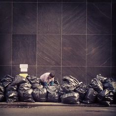 @demotix Searching for recyclables amid the trash in New York City. (via @skyler_reid)