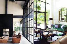 All those beautiful industrial steel windows and that gorgeous, I just want to sink into it for a week, green velvet sofa.  Just brilliant design.  BWE