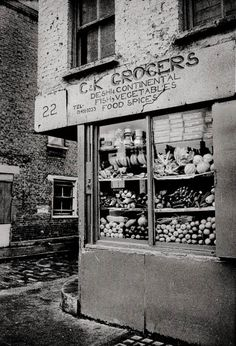 """C K Grocers, Spitalfields, East End of London. """"From the floor to the roof, the shop was stocked full of everything you could imagine."""" (1982)"""