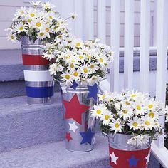 4th of July party: Give ordinary galvanized flower buckets a unique look by painting red, white and blue stripes and pasting paper star cutouts on them.