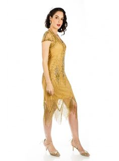 This Flapper Style Fringe Party Dress in Antique Gold recaptures the glamour of 1920's fashion. The classic scalloped sleeves and soft V-neck preserve the vintage look, while highlighting the modern fit. Flapper Style Dresses, Gold Sequins, Preserve, Vintage Looks, Antique Gold, Hemline, Vintage Inspired, Party Dress, Vintage Fashion