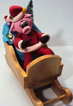 Pig Santa Sleigh figurine