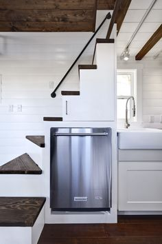 Utilize space by putting your dishwasher beneath the staircase.