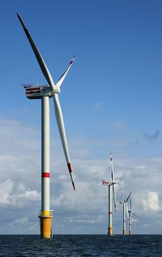 Windmills: Wind is the natural resource that can be used to generate wind power. These are 5MW wind turbines on this ' Wind Farm,' 28 km off the coast of Belgium.
