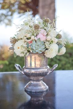 @Emily Wood@Denise Wood I have two of these vintage trophy vases! We can use them... and check out the succulents!
