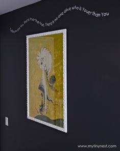 Love the contrast of painting one wall the dark navy and framing the Dr. Seuss print in a high gloss white frame to make the picture really pop. Then weaving the inspirational text around the poster