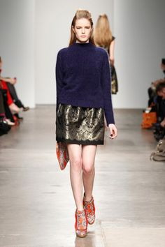 This trend is on the runways too! Karen Walker showed these funky booties with a bold skirt and baggy cardigan