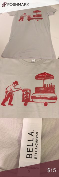 """Bella Canvas T-Shirt """"The Hot Dog Cart"""" Need a fun fun graphic tee with a Bansky-esque look? Check this cute tee out.  This could be a conversation starter this spring and summer.  Excellent Used Condition.   Size Small  Approx Measurements: Length, 26"""" Chest, 16"""" Sleeves, 6""""  100%cotton  Please ask all questions before purchasing. Bella Canvas Tops Tees - Short Sleeve"""
