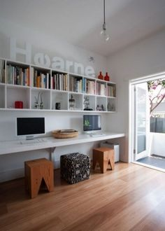 Love the cube wall shelving at a nice height above the desks.  Looking at doing this with Expedit shelving from Ikea.