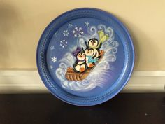 I Hand painted these cute little penguins riding a sled down the snow. It is painted on a tin plate that is for decoration only. Joy Ride, Painted Plates, Pine Cones, Decorative Plates, Christmas Ornament, Tableware, Penguins, Handmade Gifts, Painting
