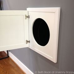 It's a built in tunnel to throw your dirty laundry into the laundry room! It's genius!