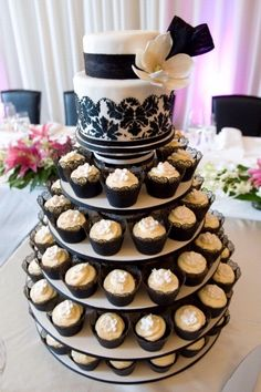 two tier top tier cupcake wedding cake. i feel like this looks like what you described to me!!