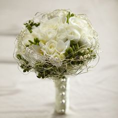 The FTD® Evermore™ Bouquet is a romantic display of modern sophistication. White roses, spray roses, freesia and hydrangea are accented with green hypericum berries and presented in an elegant gold wi Bridal Flowers, Flower Bouquet Wedding, Boquet, Flower Bouquets, Pearl Bouquet, Bouquet Champetre, Same Day Flower Delivery, Bride Bouquets, Bridesmaid Bouquet