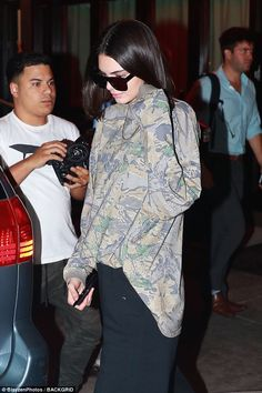 Straight up: The Keeping Up With The Kardashians star wore her bobbed hair sleek and loose around her shoulders