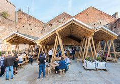 A dramatic timber canopy has been used to shelter the Constellations Bar, a new community space in Liverpool that picked up the winner's trophy in the Commercial and Leisure category of the Wood