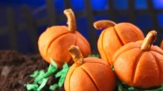 Enjoy Halloween-style dessert anytime with these pumpkin shaped candies made using peanut butter chips, pretzel twists and vanilla frosting.
