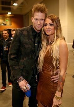Singer Brian Kelley (L) of Florida Georgia Line and Brittney Marie Cole attend the 2014 American Country Countdown Awards at Music City Center on December 15, 2014 in Nashville, Tennessee.