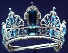 Made in 1957 by Garrard using aquamarines given to Queen Elizabeth from the President and People of Brazil on the occasion of her 1953 coronation.  In 1971 it was adapted to include four scroll ornaments taken from another smaller tiara given to Queen Elizabeth by the Governor of Sao Paulo in 1968.