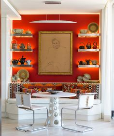 The owner's portrait presides over the breakfast area's banquette.