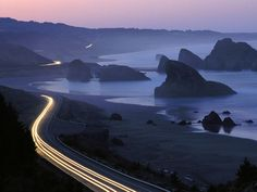 Photograph by Phil Schermeister    Headlights weave a path along Highway 101 south of Gold Beach, Oregon, in this time exposure. The historic highway was commissioned in the 1920s and runs along the coasts of Washington, Oregon, and California.