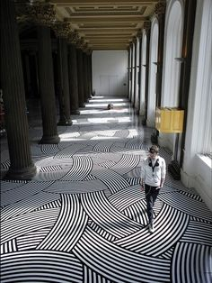 patterned floor - great space - that floor diminishes perspective and opens it up visually.