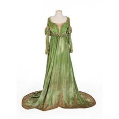 """Mary Pickford """"Katherine"""" green velvet 2-piece gown with beaded bodice from The Taming of the Shrew (UA, 1929).  Gown consists of long full skirt with gold brocade pattern along the lower hem, silk lining, and snap closure at the rear."""