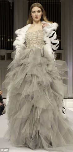 Teen supermodel Lindsey Wixson in a silver and dove grey evening gown by Oscar de la Renta .