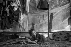 A refugee Syrian boy waking up inside his family's tent in the Bekaa Valley, Lebanon | #Syria #Refugees