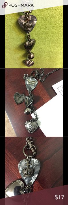 Unusual necklace with locket that opens Two hearts one that opens, a Fender guitar pick and a few other things hanging from a long chain Jewelry Necklaces
