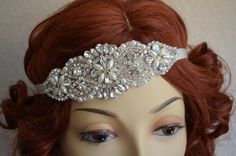 Only $58.00 WOW! I love the details with different shape rhinestones and pearls. Can be worn as a flapper, headband or bracelet.