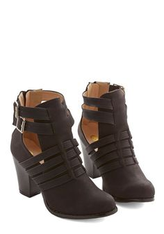 You express style that rocks from morning to midnight when your look is grounded in these black vegan faux-leather booties! Wielding a collection of straps, sizable side cutouts, and sturdy heels, these back-zipped ankle boots were made for an on-the-go trendsetter like you.