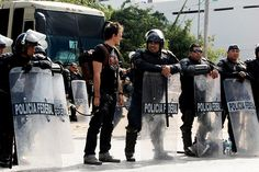 Activists meets the Federal Police in riot gear ready for action at the UNFCCC in Cancun, Mexico. Photo by Tristan Bayer Movie Photo, Thin Blue Lines, Cops, Revolution, Police, Action, The Unit, Cancun Mexico, Activists