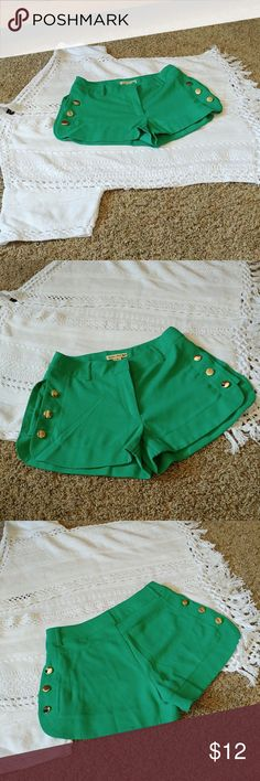 { Double Zero } Teal & Metal Embellished Shorts NEW without tags!! Adorable shorts.....very flattering!!! Soft teal green color, 6 silver metal buttons up each side. Lightweight polyester feel. No stains, no holes, no fade or pilling.  Inseam measures 2.5 in. Waist measures 12.5 in. lying flat. Thanks!!! Double Zero Shorts